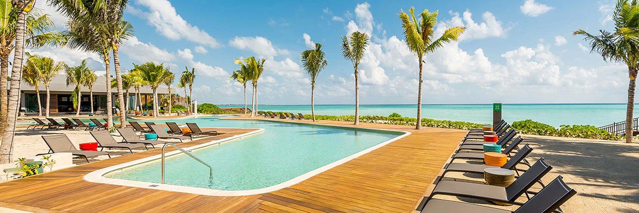 Andaz-Mayakoba-Resort-Riviera-Maya-P015-Pool-Beach-View-Sunchairs.masthead-feature-panel-medium.jpg